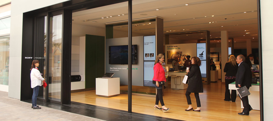 Shoppers walking on bamboo floors installed at a Sony store