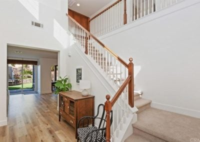Natural elm vinyl flooring next to the staircase